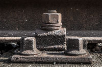 old rusty screw , iron bolts on railway