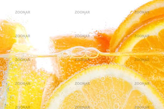 Oranges and lemons in club soda