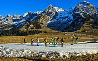 Kids practicising on improvised cross-country skiing runs, Massif des Aravis, Haute-Savoie, France