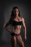 Fitness bikini. Photo of pretty female bodybuilder