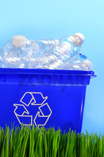 Bottles in recycling container bin