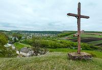 Wooden cross near spring Rukomysh Cave temple, Ternopil Region, Ukraine.