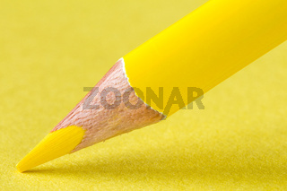 Yellow pencil on paper close-up
