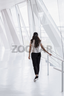 Woman walking on a modern hallway