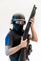 Terrorism, man armed with balaclava and bulletproof vest, gun and shotgun, kalashnikov