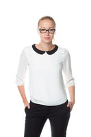 Business woman standing arms in pockets against white background..