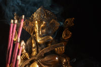 Ganesha and incense sticks