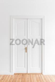 restored old door in renovated flat