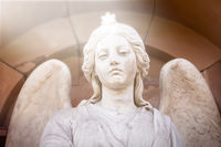 marble sculpture of an angel with a star on his head