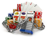 Gambling addiction concept. Slot machine, casino chips and chain with lock.