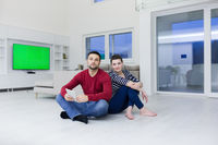 Young Couple using digital tablet on the floor