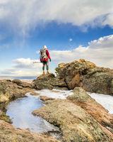 mature backpacker on a mountain ridge