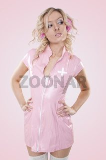 smiling sexy woman young looking nurse wearing pink latex dress and white stockings