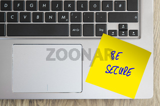 Laptop with note BE SECURE