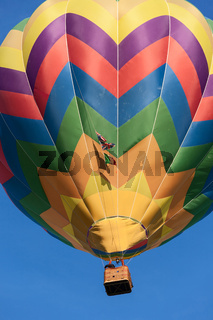 Colored hot-air balloon in flight