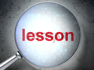 Education concept: Lesson with optical glass