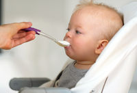 Feeding baby with spoon