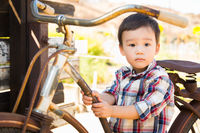 Mixed Race Caucasian and Chinese Young Boy Having Fun on the Bicycle.