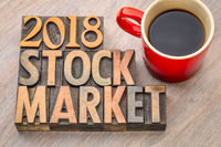 2018 stock market word abstract in wood type