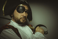Sailor, Man with beard dressed like a pirate, with eye patch and steel sword