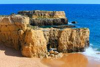 Yellow cliffs on beach (Algarve, Portugal).