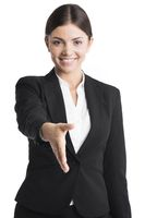 Business woman stretching hand for shaking