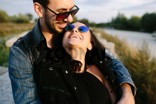 guy hugging tenderly his girlfriend