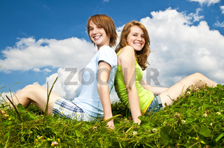 Young girls sitting in meadow