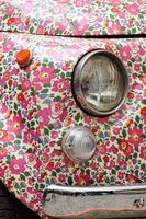 Detail of Fiat 500 wrapped with flowery pattern