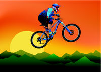 Image of a cyclist on a background of mountains and evening sky