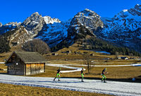 Three cross-country skiers practicising skating technique without poles, Haute-Savoie, France
