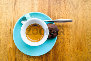 An espresso served in a turquoise cup
