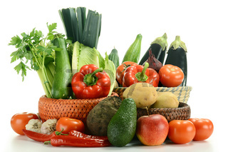 Variety of fresh vegetables on white