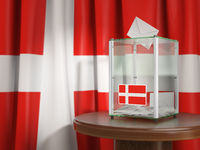 Ballot box with flag of Denmark and voting papers. Danish presidential or parliamentary election .