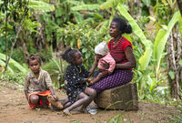 Mother with her three kids, Ambavaniasy, Madagascar
