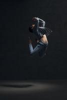Girl in jeanswear dancing gracefully in the dark