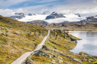Straight mountain road leading to spectacular glaciers and lakes.