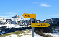 Directional signs pointing in opposite directions, Schwende, Switzerland