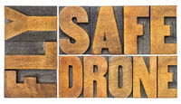 fly safe drone word abstract in wood type