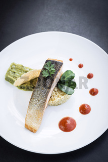 gourmet salmon fish  fillet with rice and guacamole meal