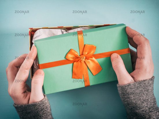 female hands opening gift box