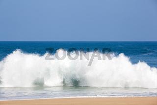 Strong waves crash over the beach at Lumahai on Kauai