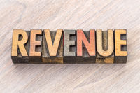 revenue word abstract in wood type