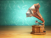 Vintage gramophone on green background.