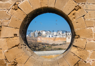 View of Essaouira through hole in wall