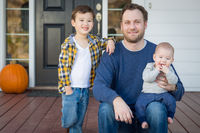 Mixed Race Father and Sons on Front Porch