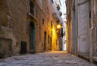 The narrow street Is - Sirena on Senglea in the early morning. Malta