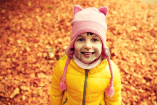 happy little girl in autumn park