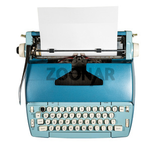 Old electric typewriter on white background