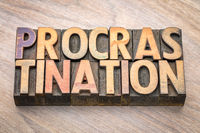 procrastination word abstract in wood type